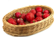 Radishes. Red radishes in Wicker basket on white background Stock Photos