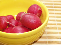 Radishes. Fresh radishes in bowl of yellow earthenware Royalty Free Stock Photography