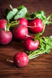 Radishes on a Cutting Board. Fresh radishes on a wooden cutting board Royalty Free Stock Image