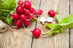 Radishes. Fresh radishes on a wooden background Royalty Free Stock Photos