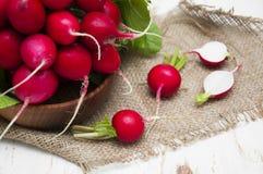 Radishes. Fresh radishes on a wooden background Royalty Free Stock Photography