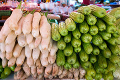 Radishes and gourd. At the vegetable market Royalty Free Stock Image