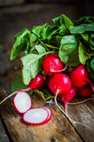 Radishes on rustic wooden background Royalty Free Stock Image