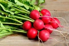 Radishes on wood. Fresh radishes on wooden background Stock Images