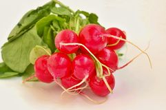 Radishes on the wooden background. Front horizontal view Royalty Free Stock Image