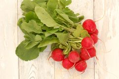 Radishes on the wooden background. Overhead horizontal view Stock Photo