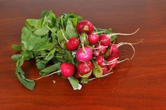 Radishes on a wooden board. Fresh radishes on a wooden board Stock Photo