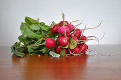 Radishes on a wooden board. Fresh radishes on a wooden board Stock Photos