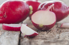 Radishes on wooden table Royalty Free Stock Photography