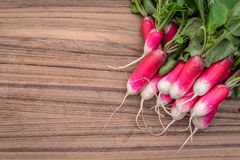 Radishes on a wooden table Stock Photo
