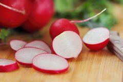 Radishes on wooden table Stock Photos