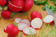Radishes on wooden table Stock Images