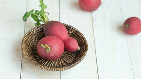 Radishs in basket on white background. Red radishs in basket on white background Royalty Free Stock Photo