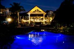 Radisson Blu Fiji. Night: Blu water under a blue night sky, the restaurant overlooking a function on the waterfall lawn. Fiji Resort living stock photos