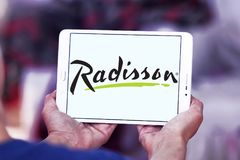 Radisson Hotels logo. Logo of Radisson Hotels on samsung tablet. Radisson Hotels is an international hotel company and a subsidiary of the Radisson Hotel Group stock image