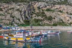 Raditional fishing boats at the fishing harbour of Sesimbra. Sesimbra, Portugal. February 22, 2015: Traditional fishing boats at the fishing harbour of Sesimbra Royalty Free Stock Photography