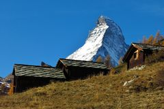 Raditional hutts with stone roof and Matterhorn Royalty Free Stock Photos
