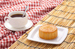 Raditional moon cakes on table setting with teacup. Royalty Free Stock Photography
