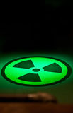 Radium Symbol on Floor in Green Light Stock Image