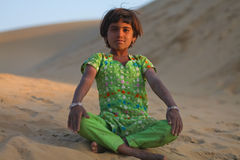 Radjastani girl. JAISALMER – DECEMBER 10 : Young Rajasthani girl in desert on December 10, 2010. About 40% of the total population of Rajasthan state live Royalty Free Stock Image