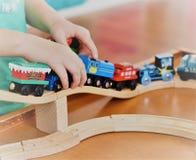 Radość bawić się z drewnianymi pociągami fotografia royalty free