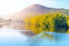 Radobyl Mountain in Ceske Stredohori, Central Bohemian Uplands. View from Labe River in Litomerice, Czech Republic.  stock photography