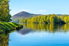 Radobyl Mountain in Ceske Stredohori, Central Bohemian Uplands. View from Labe River in Litomerice, Czech Republic.  royalty free stock photos