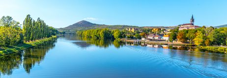 Radobyl Mountain in Ceske Stredohori, Central Bohemian Uplands. View from Labe River in Litomerice, Czech Republic.  stock photos