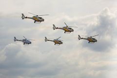 RADOM, POLAND - AUGUST 23:Aerobatic Spanish helicopter patrol (A Royalty Free Stock Photography