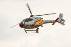 RADOM, POLEN - 23. AUGUST: Aerobatic spanische Hubschrauberpatrouille (A Lizenzfreie Stockbilder