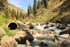 The radon hot spring near the Altyn Arashan resort near Karakol city, Kyrgyzstan Royalty Free Stock Photography