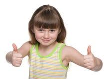 Radosna młoda dziewczyna trzyma jej aprobaty Fotografia Royalty Free