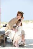 Radosna w średnim wieku kobieta siedzi outdoors Obrazy Royalty Free