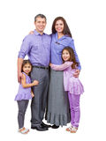 Radosny i kochający mieszanego rodzina stojaka, uśmiech i Obrazy Stock