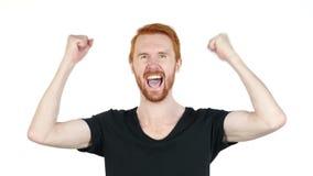 Radosny młody człowiek gestykuluje, szczęście, sukces, dobre wieści, biały tło zbiory