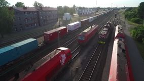 RADVILISKIS LITHUANIA, CZERWIEC, - 28, 2018: Litewska Kolejowa sieć z pociągami i linią kolejową w tle zbiory