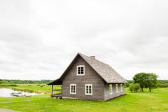 RADVILISKIS, LITHUANIA - JUNE 12, 2014: Unique Village and Rural Area in Lithuania with Wooden Building. Green grass and forest in Royalty Free Stock Images