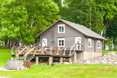 RADVILISKIS, LITHUANIA - JUNE 12, 2014: Unique Village and Rural Area in Lithuania with Wooden Building and Green Grass Royalty Free Stock Photos