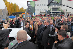 RAE-2013. NIZHNY TAGIL, RUSSIA - SEP 26: Government delegation headed by Prime Minister Dmitry Medvedev at the exhibition RUSSIA ARMS EXPO (RAE-2013) on Royalty Free Stock Images