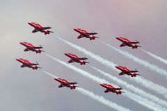 Royal Air Force RAF Red Arrows formation aerobatic display team flying British Aerospace Hawk T.1 Jet trainer aircraft. Royalty Free Stock Photo