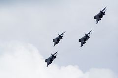 RAF Harriers flyby. 4 RAF AV-8 Harriers flyby in formation on an overcast day Royalty Free Stock Image