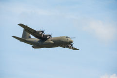 RAF Hercules. Duxford,UK - 25 May 2014: An RAF Hercules flying at  Duxford D-Day Airshow Royalty Free Stock Images