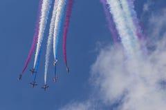 RAF Red Arrows in BAE Hawk T1 trainers. Farnborough International Airshow, Farnborough Airport, Rushmoor, Hampshire, England royalty free stock image