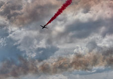 RAF Red Arrows Display Team. British RAF Red Arrows Display Team at Biggin Hill airshow, June 2016 on a stormy day Stock Photography