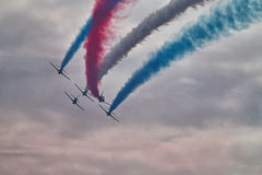 RAF Red Arrows Display Team. British RAF Red Arrows Display Team at Biggin Hill airshow, June 2016 on a stormy day Stock Photos