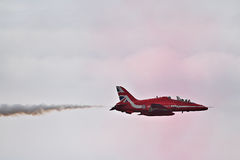 RAF Red Arrows Display Team. British RAF Red Arrows Display Team at Biggin Hill airshow, June 2016 on a stormy day Stock Image