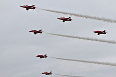RAF Red Arrows Display Team. British RAF Red Arrows Display Team at Biggin Hill airshow, June 2016 on a stormy day Royalty Free Stock Photography