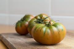 Raf tomatoes, salad greens Stock Photo