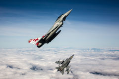 RAF Typhoon and Tornado jet fighters of 41RTES, Royal Air Force, over the English countryside. Royalty Free Stock Photos