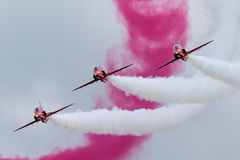 Royal Air Force RAF Red Arrows formation aerobatic display team flying British Aerospace Hawk T.1 Jet trainer aircraft. Stock Photo